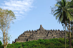 Indonesia, Java, Borobudur: Temple. Indonesia, Java, Borobudur: javanese landscape with blue sky and the borobudur temple. one of the most typical images of royalty free stock images