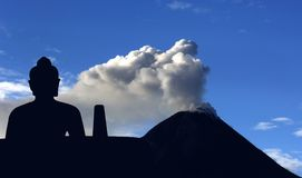 Indonesia, Java: Merapi eruption, may 2006. And buddha in meditation royalty free stock images