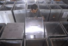 INDONESIA LOCAL ELECTIONS 2015 NUMBER OF VOTERS. Officials prepare voting boxes and ballot papers before the Indonesian General Election 2014, at Solo, Java Royalty Free Stock Photography