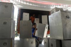 INDONESIA LOCAL ELECTIONS 2015 NUMBER OF VOTERS. Officials prepare voting boxes and ballot papers before the Indonesian General Election 2014, at Solo, Java Royalty Free Stock Photos