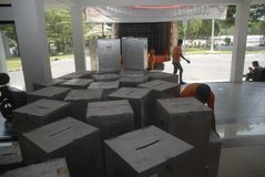 INDONESIA LOCAL ELECTIONS 2015 NUMBER OF VOTERS. Officials prepare voting boxes and ballot papers before the Indonesian General Election 2014, at Solo, Java Stock Image