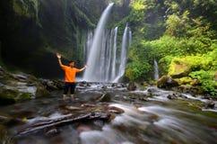 INDONESIA, LOMBOK 20 sept 2017. Beautiful scenery of Tiu Kelep waterfall in senaru. Tourist enjoying their vacation during summer. INDONESIA, LOMBOK 20 sept stock photography