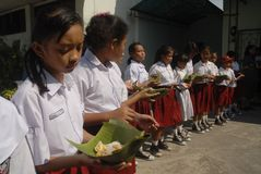 INDONESIA LOWEST SKILLED GRADUATE. Elementary school students eat their breakfast in Solo, Java, Indonesia. International multi finance group Credit Suisse noted Royalty Free Stock Photo