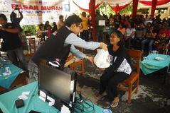 INDONESIA MALNUTRITION. Free food package distribution in Solo, Java, Indonesia. United Nation's World Food Programme stated that malnutrition costs Indonesia Royalty Free Stock Photo