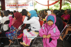 INDONESIA MALNUTRITION. Free food package distribution in Solo, Java, Indonesia. United Nation's World Food Programme stated that malnutrition costs Indonesia Royalty Free Stock Photography