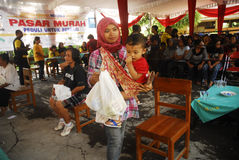 INDONESIA MALNUTRITION. Free food package distribution in Solo, Java, Indonesia. United Nation's World Food Programme stated that malnutrition costs Indonesia Royalty Free Stock Images