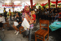 INDONESIA MALNUTRITION. Free food package distribution in Solo, Java, Indonesia. United Nation's World Food Programme stated that malnutrition costs Indonesia Royalty Free Stock Photos