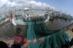 Indonesia Maritimes Regulation. The fisherman was on the boat at Muncar Beach, Banyuwangi, East Java, Indonesia Royalty Free Stock Image