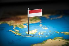 Indonesia marked with a flag on the map royalty free stock images