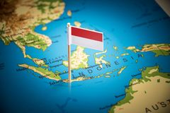 Indonesia marked with a flag on the map royalty free stock photography