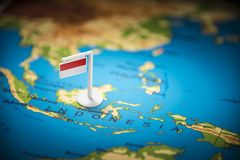 Indonesia marked with a flag on the map royalty free stock photo
