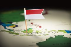 Indonesia marked with a flag on the map stock images