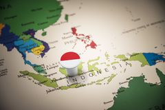 Indonesia marked with a flag on the map royalty free stock image