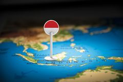 Indonesia marked with a flag on the map stock image