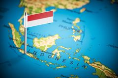 Free Indonesia Marked With A Flag On The Map Royalty Free Stock Image - 136430606