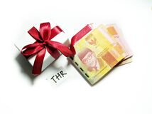 Indonesia. 20 May 2020. Religious Holiday Allowance (THR) with gift box and Indonesian currency