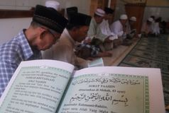 INDONESIA MUSLIM RECITE KORAN Stock Photography