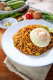 Indonesia Nasi Goreng fried rice with egg on white plate Royalty Free Stock Photography