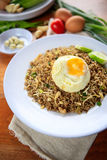 Indonesia Nasi Goreng fried rice with egg on white plate Royalty Free Stock Image