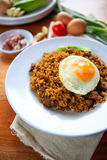 Indonesia Nasi Goreng fried rice with egg on white plate Stock Images