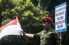 INDONESIA NATIONALISM SENTIMENT. Army Cpl. Partika Soebagyo wave Indonesian Flag at a self hosted loyalty action at Solo, Java, Indonesia. Indonesia use Royalty Free Stock Photo
