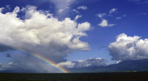 Indonesia rainbow. Rainbow over a vast part of the ocean in the Sulawesi Sea Stock Photography