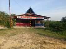 Indonesia,Riau province,Kampar district,. A small restaurant with wood and  with a Shed canopy