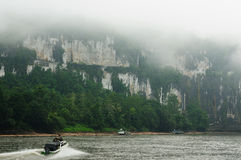 Indonesia river, Borne. Scenic view of wild tropical jungleand speed boat on the Mahakam river, East Kalimantan, Indonesia Borneo Stock Photography