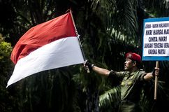INDONESIA'S STRONGEST ARMY MAN. Cpl. Partika Subagyo of Indonesian Army, which is dubbed as Indonesia's Toughest Soldier. Subagyo is the official national record Stock Image