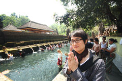 Indonesia - Sep 20, 2012 : Thai handsome man tourist at Pura Tir Stock Photos