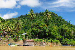 Indonesia - Stilt village on the river, Borneo Stock Photography