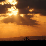 Indonesia sunset. Sunset with a silhouette of a working man in Indonesia Stock Photo