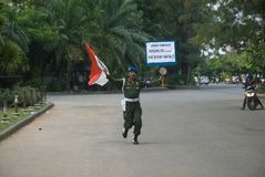 INDONESIA TNI PROFESSIONALISM. Cpl. Partika Subagyo of Indonesian Army hold a one person rally to support military professionalism of Indonesian Armed Forces ( Royalty Free Stock Photo