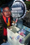 INDONESIA TO INVESTIGATE TOP LAW ENFORCEMENT OFFICIALS ON CORRUPTION. A protester mocks the former Chief Justice of Indonesian Constitutional Court Akil Mochtar stock photos