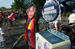 INDONESIA TO INVESTIGATE TOP LAW ENFORCEMENT OFFICIALS ON CORRUPTION. A protester mocks the former Chief Justice of Indonesian Constitutional Court Akil Mochtar royalty free stock image