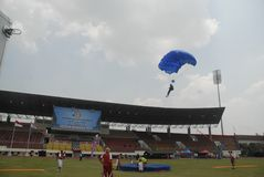 INDONESIA TO RENOVATE ASIAN GAMES FACILITIES. Parachutist participate at the 38th World Military Parachuting Championship in Solo, Java, Indonesia. The Asian Royalty Free Stock Image