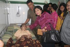 INDONESIA TO STOP SENDING MIGRANT WORKERS ABROAD. Erwiana, an abused Indonesian migrant worker, was visited by sympathizers while treated on Amal Sehat Hospital royalty free stock photography