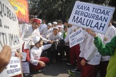 INDONESIA TOLERANT MODERATE MUSLIMS. Indonesian Muslims people. Although a Muslim majority nation with 210 million followers or 87 percent of total population royalty free stock image