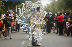 INDONESIA TOURISM REVENUE. The Solo Batik Carnival held annually in Solo, Java, Indonesia. The Indonesian government needed to spend around US$11.5 million on royalty free stock photo