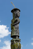Indonesia - Traditional Dayak tribal culture. Traditional Dayak tribal culture. Totem in front of Dayak house - long house. East Kalimantan, Indonesia, Borneo Royalty Free Stock Image