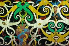 Indonesia - Traditional Dayak tribal culture. Traditional Dayak tribal culture. Ancient detail painting of the Dayak house - longhouse in Long Hubung village Stock Image