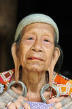 Indonesia - Traditional Dayak tribal culture, Borneo. LONG BAGUN, BORNEO, INDONESIA - 10 JULY 2011: The older Dayak women with traditional long earlobes and Stock Photo
