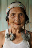 Indonesia - Traditional Dayak tribal culture, Borneo. LONG BAGUN, BORNEO, INDONESIA - JULY 07: The older Dayak women with traditional long earlobes and tattoo Stock Images