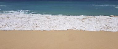 Indonesia tropical beach, waves gently break on a sunny day. Summer time stock images