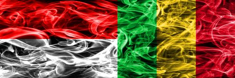 Indonesia vs Mali smoke flags placed side by side. Thick colored. Silky smoke flags of Indonesian and Mali Stock Images