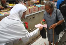 Indonesia women day. Some student share flower to women in the market to commemorating indonesia women day in solo, central java, indonesia Royalty Free Stock Photography