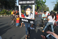 An Indonesian activists celebrate Malala Yousafzai Nobel Peace Prize award. Royalty Free Stock Photography