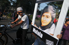 An Indonesian activists celebrate Malala Yousafzai Nobel Peace Prize award. Stock Photography