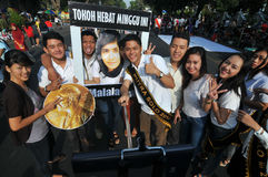An Indonesian activists celebrate Malala Yousafzai Nobel Peace Prize award. Royalty Free Stock Images