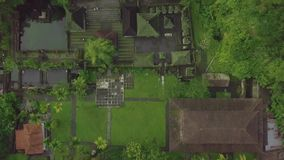 Indonesian architecture building and Hindu temple with water pond on tropical Bali island. Aerial view territory Hindu. Temple with tropical garden and pond stock footage